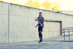 Man exercising with jump-rope outdoors Royalty Free Stock Images