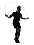 Man exercising jumping rope silhouette Royalty Free Stock Images