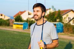 Man exercising with jumping rope. At a stadium royalty free stock photography