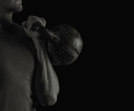 Man exercising with kettlebell. Man exercising with a kettlebell, black and white image Royalty Free Stock Photography