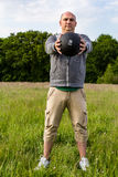 Man exercising with 3 kilos medicine ball outdoors. He is doing sport royalty free stock photography