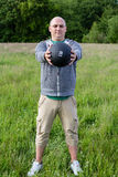 Man exercising with 3 kilos medicine ball outdoors. He is doing sport royalty free stock images