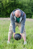 Man exercising with 3 kilos medicine ball outdoors. He is doing sport stock images