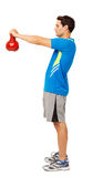 Man Exercising With Kittle Bell Stock Images