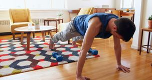 Man exercising in living room 4k stock footage