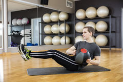 Man Exercising With Medicine Ball In Gym Stock Photography