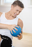 Man Exercising With Medicine Ball In Gym Stock Images
