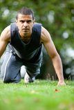 Man exercising outdoors Stock Images