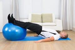 Man exercising on a pilates ball Stock Photos
