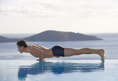 A man exercising by a pool Royalty Free Stock Photos