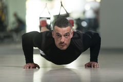 Man Exercising Push Ups With Trx Straps Royalty Free Stock Photography