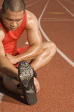 Man Exercising On Racetrack Stock Photography