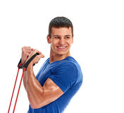 Man exercising with rubber expander. portrait Royalty Free Stock Photo