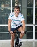 Man Exercising On Spinning Bike Royalty Free Stock Photos