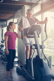 Man exercising on stationary bikes in fitness class. Man Stock Images