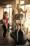 Man exercising on stationary bikes in fitness class. Man Stock Photography