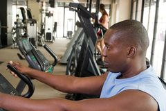 Man Exercising On Stationary Cycle Royalty Free Stock Photo