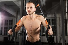Man Exercising With Suspension Trainer Stock Photography
