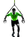 Man exercising suspension training  trx silhouette Royalty Free Stock Images