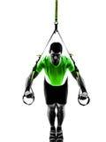 Man exercising suspension training  trx silhouette Royalty Free Stock Photos
