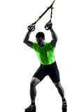 Man exercising suspension training  trx silhouette Royalty Free Stock Photos