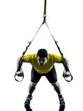 Man exercising suspension training  trx silhouette Stock Images