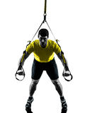 Man exercising suspension training  trx silhouette Royalty Free Stock Photo