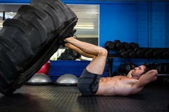 Man exercising with tire in gym Royalty Free Stock Photos