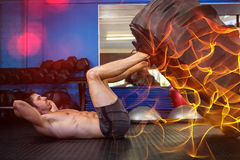 Man exercising with tire in gym Royalty Free Stock Images