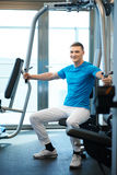 Man exercising in trainer for pectoral muscles Stock Photos