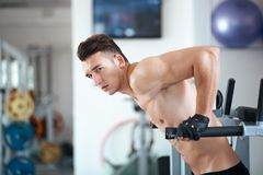 Man exercising in trainer for pectoral muscles Royalty Free Stock Photography