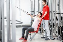 Man exercising with trainer at the rehabilitaion gym stock images