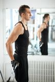Man exercising in trainer for triceps muscles Stock Photos