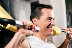 Man exercising and training in gym Royalty Free Stock Photo
