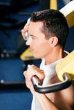 Man exercising and training in gym Stock Image