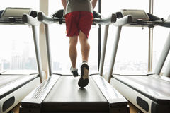 Man exercising on treadmill in gym Stock Photography