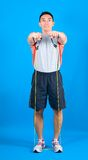 Man exercising with tubing Stock Images