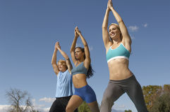 Man Exercising With Two Women In Park Royalty Free Stock Photos