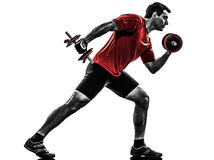 Man exercising weight training silhouette Royalty Free Stock Photo
