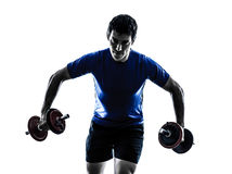 Man exercising weight training silhouette Royalty Free Stock Images
