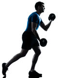 Man exercising weight training workout fitness Stock Photos