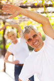 Man exercising wife Royalty Free Stock Photos