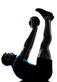 Man exercising workout  fitness ball. One caucasian man exercising workout holding fitness ball posture in silhouette studio  isolated on white background Stock Photos