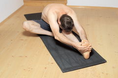 Man is exercising yoga Royalty Free Stock Images