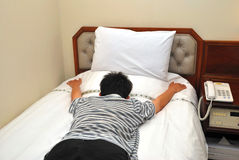 Man exhausted and lying on bed Royalty Free Stock Images