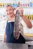 Man exhibiting a white salmon Royalty Free Stock Photography