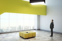 Man in exhibition hall. Side view of young man standing in modern exhibition hall interior with panoramic city view. Museum concept. 3D Rendering Stock Image