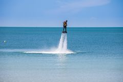 Man exibition on flyboard Stock Image