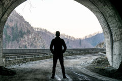 Man on the exit from the tunnel.  Stock Photography