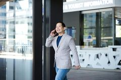 Man exiting building with mobile phone Royalty Free Stock Photo